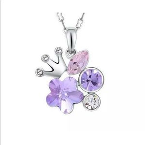 Multicolored jeweled silver necklace with crown